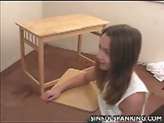 Sexy brunette teen spanked by the teacher