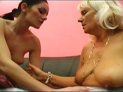 Horny granny playing a young cunt
