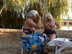 Delightful lesbian grannies fervent pussy fun outdoors