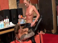 Horny lesbians greasing up and finger fucking