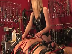 Dominatrix pours pee on subs mouth