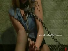 Whore in chains dressed in stockings