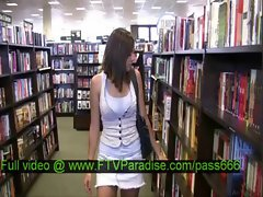 Miyu teen redhead babe walking in a library