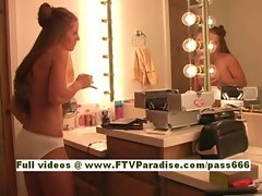 Emma cute blonde babe does her hair in the bathroom