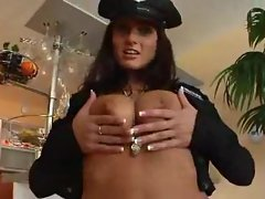 Sexy cop with natural tits sucks cock