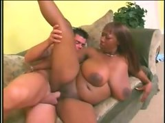 Big sexy black girl sits on a fat dick