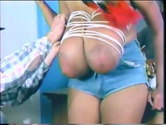Cowboy plays with tied up Indian titties