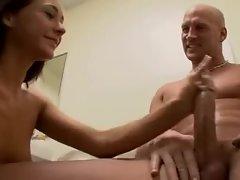 Skinny girl strokes a big cock in the bathroom