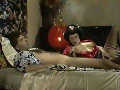 Geisha girl in satin sucks a cock