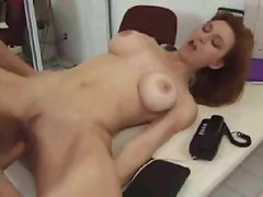 Milf redhead nailed hard on a desk