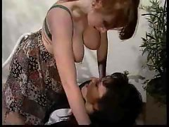 Hot lesbian milfs use a strapon for fun