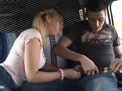 Busty teen gives a handjob in a van