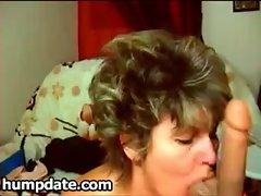 Hot mature babe deepthroats her big dildo