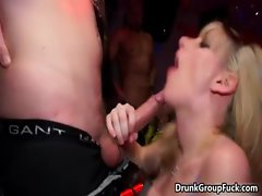 Two horny sluts love sucking on a big