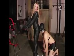 Prodomme pulls off her hooded slaves cock