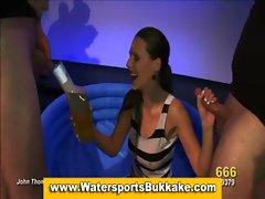 Pee drinking bitch suck throbbing dicks