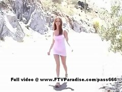 Cool babe Jackie redhead chick outdoors posing
