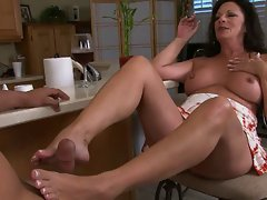 attractive mature Margo make a footjob