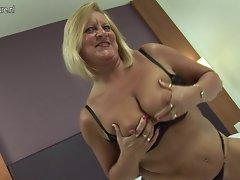 Attractive English grandma loves her fake penis