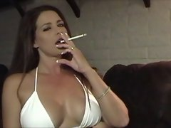 Attractive Luscious Lass in Bikini Smoking and Teasing