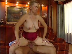 Luscious Stepmom n77 light-haired attractive mature on a red sofa