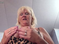 Natural grandmother pleasing her aged pussy