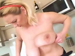 boobsy slutty mom plays in the kitchen and shower