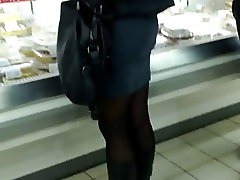 Voyeur sweet ass in skirt and nylons