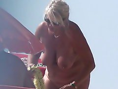 blond nudist girl getting undressed at cap d agde