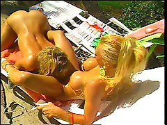 Big titted blond lezzies have sizzling poolside sex