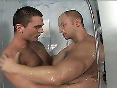 Two hard guys fucking bareback in the shower