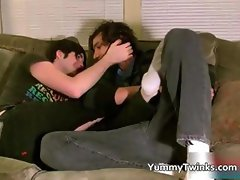 Two pretty twinks kissing on lounge part1