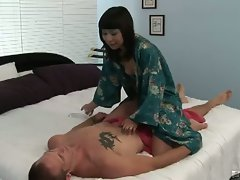 Asian girl sayurri gives him a nice massage