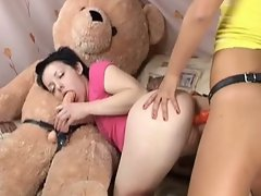 Two amateur teens fuck each other with strap on
