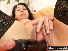 Slutty milf plugs her nice black dildo inside her pussy
