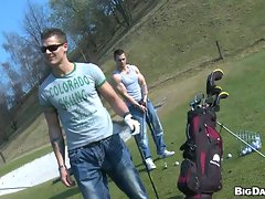 Muscular handsome studs tease each other in the golf course