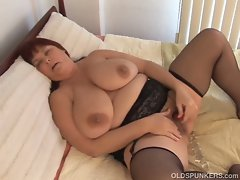Busty bbw milf is stockings toys her pussy