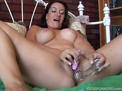 Sexy mature brunette sandy plays with her toys
