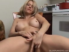 Sexy milf rubbing her pussy as hard as she can.