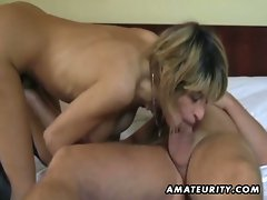Busty german girl eats two hard cocks