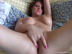 Nasty redhead milf plays and finger fucks wet pierced pussy