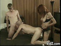Threesome fuck of gay lovers and a redheaded femdom slut