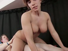 Busty brunette gives a masssage and gets nailed in hd