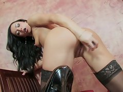 Smoking hot brunette toying tasty pussy in stockings