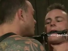 Gay man with large shoulders and tattooes gets spanked and fucked