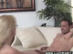 Big titted slut stroking his cock so he blasts her with cum