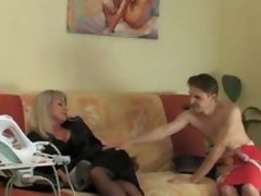 Mature woman with a young boy 17