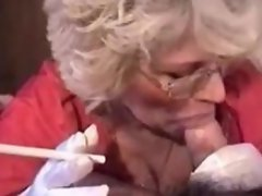 Granny in gloves smoking BJ