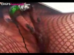 Short-haired chick in fishnets gets naked and masturbates