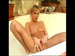Sexy blonde babe really enjoys her bath especially when she masturbates